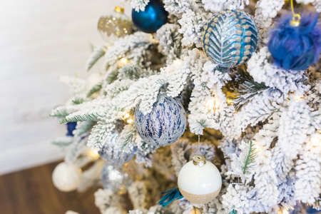 Christmas-tree decorations on a christmas fir-tree. Holidays and decor concept. 版權商用圖片 - 155319571