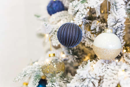 Christmas-tree decorations on a christmas fir-tree. Holidays and decor concept.