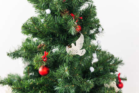 Christmas tree decorations on a christmas fir-tree, close-up. Holidays and decoration concept.