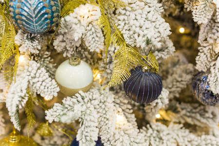 Christmas-tree decorations on a christmas fir-tree. Holidays and decor concept.