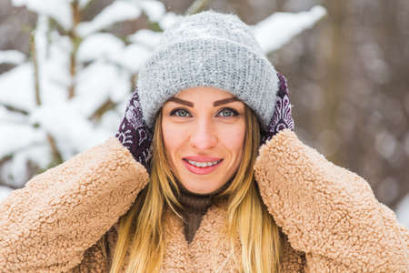 Portrait of a beautiful woman with braces on teeth. Smiling girl with dental braces. Happy smiling woman with braces in winter nature. Dental Health Concept.