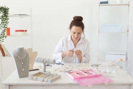Professional accessories designer making handmade jewelry in studio workshop. Fashion, creativity and handmade concept. Stock Photo