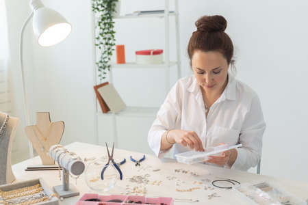 Professional accessories designer making handmade jewelry in studio workshop. Fashion, creativity and handmade concept.
