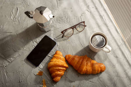 Breakfast with croissant and coffee and moka pot. Morning meal and breakfast concept. 版權商用圖片