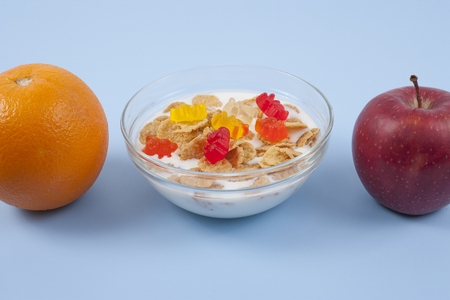 Cereals and fruit diet and breakfast on blue background