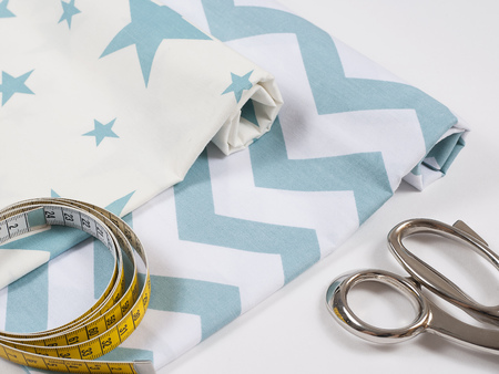 Colorful cotton fabric, meter and scissor Stock Photo - 107535687