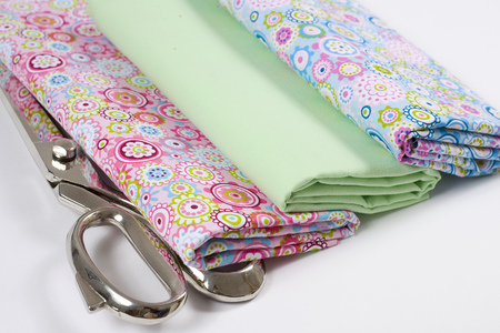 Colorful cotton fabric, meter and scissor Stock Photo - 107536390