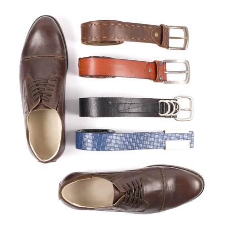 Mens leather shoes and belt on a white background Stock Photo