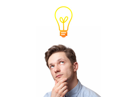 Young man with thoughtful expression and light bulb over his head
