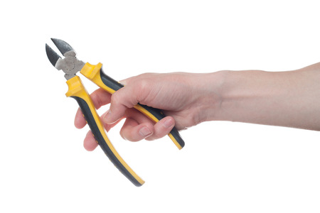 Man's hand holding a black and yellow wire cutter. Open, clean, ready to cut form.