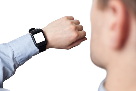 Male hand wearing smart watch with blank screen on white background