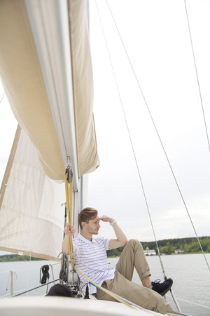 Handsome young man on yacht 版權商用圖片