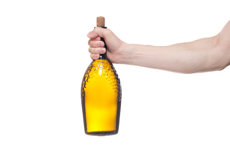 Man holding bottle with delicious wine on white background