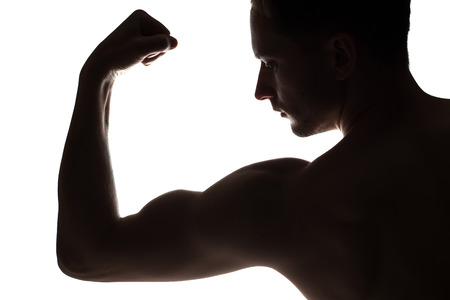 Man arm strong with muscle on white background. Muscular bodybuilder posing on white background. Strong Athletic Man Fitness Model in dark, triceps over white background. Copy space Stock Photo