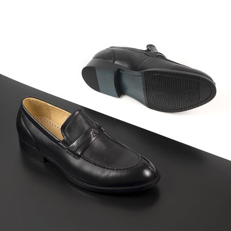 Classic male black leather shoes isolated on a white and black