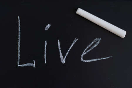 White chalk with live lettering on a black slate