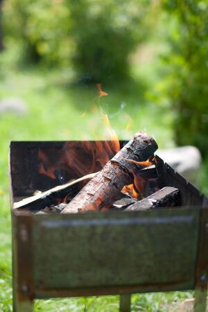 Brazier with fire and coal for cooking. Close-up. Horizontal.