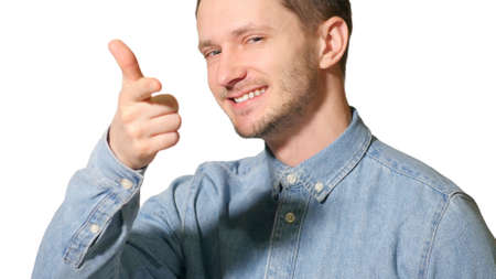 Young handsome man over isolated background happy with big smile doing ok sign, thumb up with fingers, like
