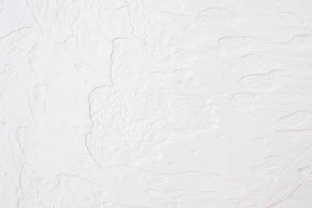 The texture of the white concrete table. White painted texture with brush and palette knife strokes for interesting and modern backgrounds. Stok Fotoğraf - 159528736