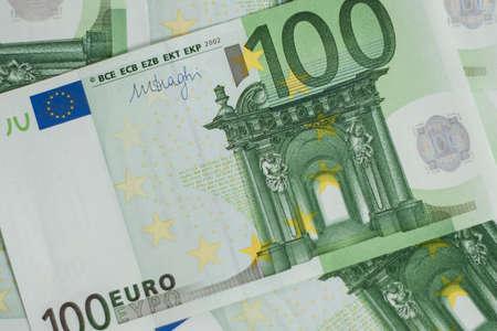 100 euro bill. Europein money banknote. Hundred euro bills on wooden background.