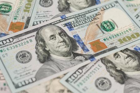 100 Dollars bill and portrait Benjamin Franklin on USA money banknote. Hundred dollar bills on wooden background. Stok Fotoğraf - 160215142