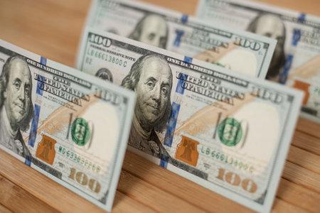 100 Dollars bill and portrait Benjamin Franklin on USA money banknote. Hundred dollar bills on wooden background. Stok Fotoğraf - 160215145