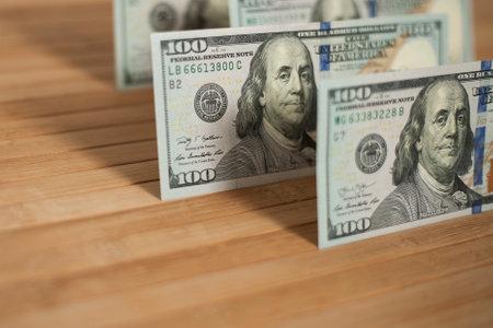 100 Dollars bill and portrait Benjamin Franklin on USA money banknote. Hundred dollar bills on wooden background. Stok Fotoğraf - 161034031