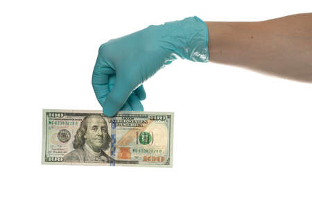 Hand with dollar banknote on white background, closeup. Money, earnings, crediting and finance. 100 Dollars bill in hand Stok Fotoğraf