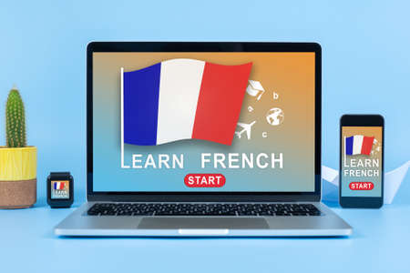 Laptop, mobile phone and smart watch with LEARN FRENCH on a screen. Education Learning English Language School Concept. Mockup Stok Fotoğraf - 161089856