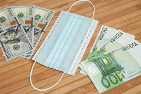 Money dollars, euro banknotes bill with face mask. Crisis and finance concept. Stok Fotoğraf