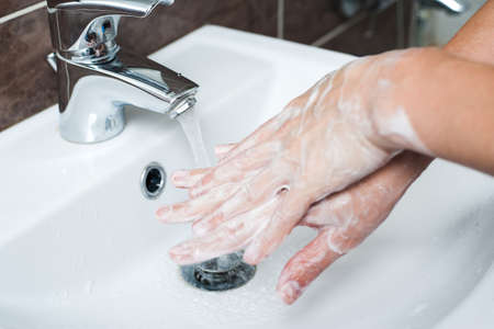 Hygiene concept. Washing hands with soap under the faucet with water Stok Fotoğraf