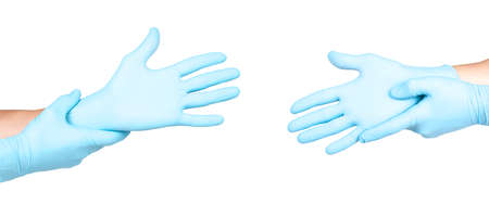 Hands of a medic in the blue latex gloves on white background Stok Fotoğraf