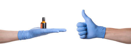 Thumbs up. Hand with blue medical glove on white background. The inside of the hand Stok Fotoğraf