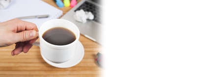hand holding cup coffee on work table background Stok Fotoğraf