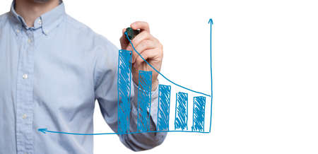 Young businessman prepare to start drawing concept. Businessman drawing a growth graph. Isolated on white. Stok Fotoğraf