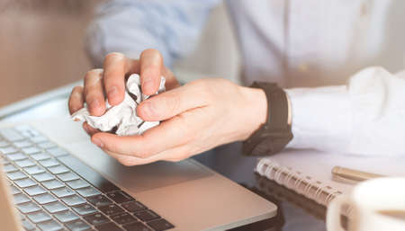 Businessman crumpling paper on his workplace. Office workplace with crumpled paper balls on the tableNo idea to thinking new idea Stok Fotoğraf