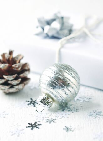 Christmas decoration and Christmas present.White background. Close up. Copy space.
