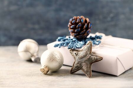 Christmas star and silver baubles. Christmas decoration. Christmas time. Wooden background. Close up.