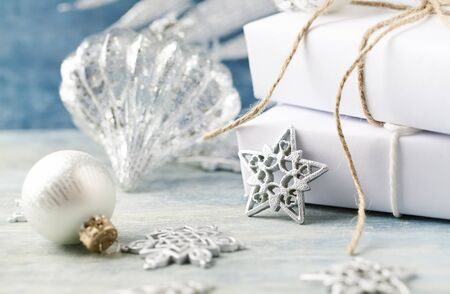 Silver Christmas star, baubles and Christmas presents. Christmas decoration. Christmas time. Wooden background. Stock Photo