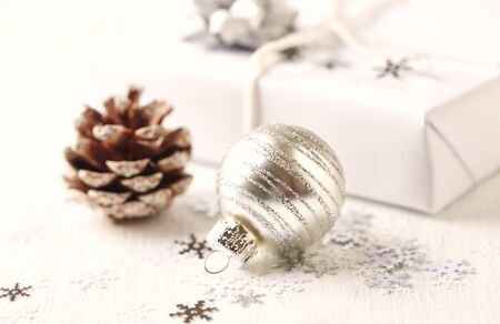 Christmas decoration and Christmas present. White background. Close up. Copy space.