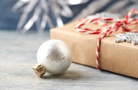 Christmas decoration and Christmas present. Close up. Copy space. Wooden background.