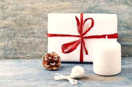 Christmas decoration and Christmas present. Christmas time. Rustic wooden background. Copy space.
