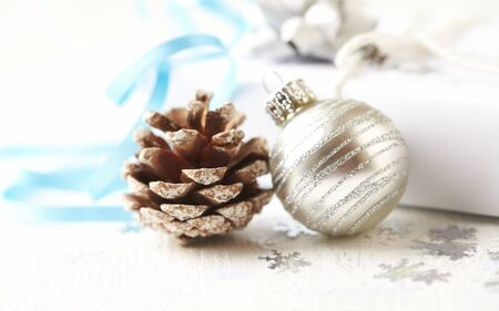 Christmas decoration and Christmas present. Close up. Copy space. White background. Stock Photo
