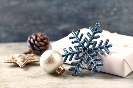 Christmas star and silver bauble. Christmas decoration. Christmas time. Wooden background. Close up. Stock Photo