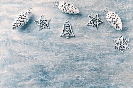 Christmas ornaments on rustic wooden background. Top view. Copy space.
