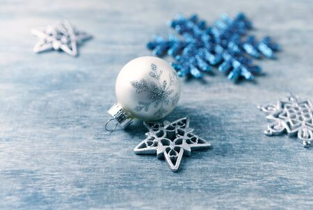 Christmas ornaments on rustic wooden background. Close up.