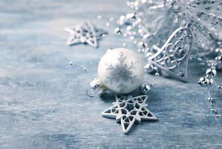 Christmas ornaments on rustic wooden background. Close up. Copy space. Stock Photo