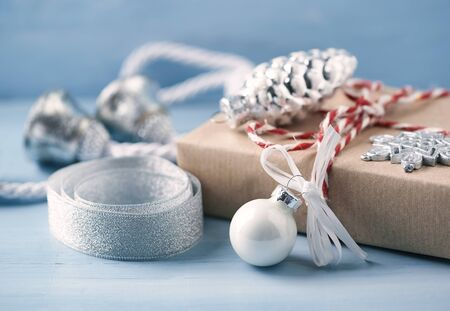 Christmas decoration and present. Bright Wooden background. Close up. Stock Photo