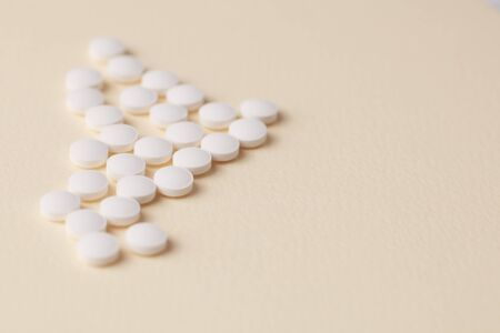 Biotin Tablets. Bright paper background. Close up. Copy space. Stock Photo