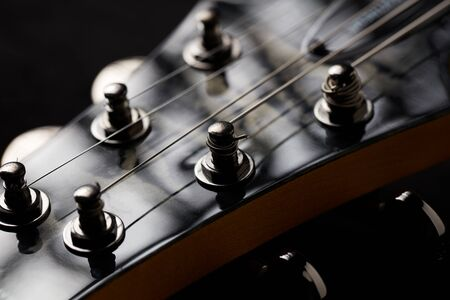 The head of electric guitar (close up) Imagens